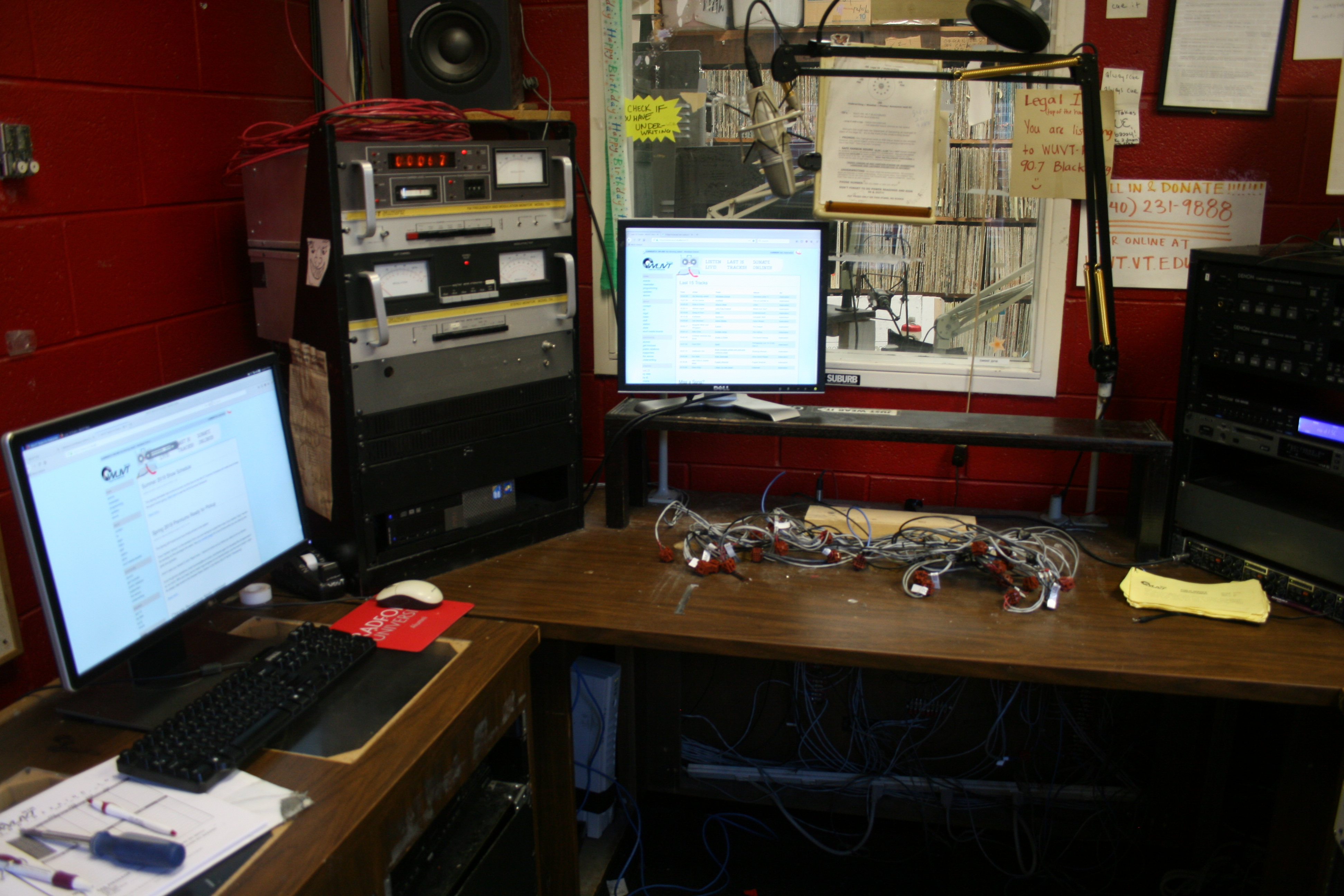 a photo of the desk in the FM studio with the old board missing